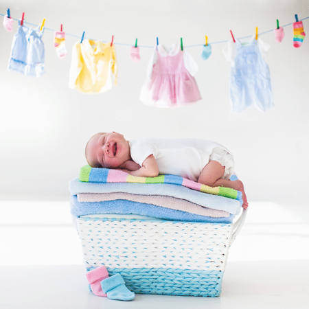 New Born Baby on Basket of Coloured Towels