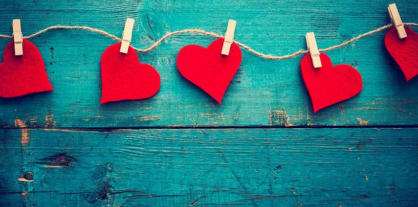 Relationships red hearts pegged to a line